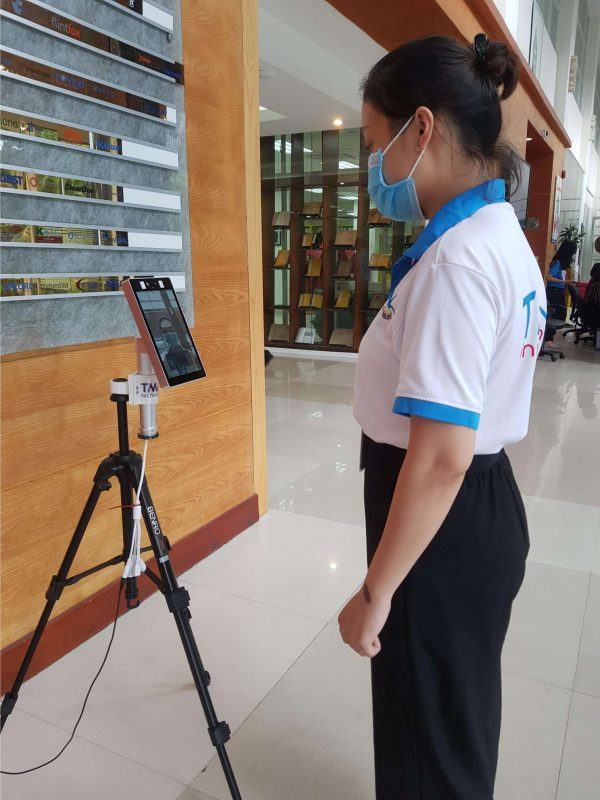 Woman being checked by Short-range Thermal Camera